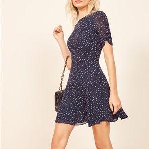 Cute navy with white polka dots mini dress!